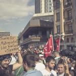 Syrian Refugee Holds Sign